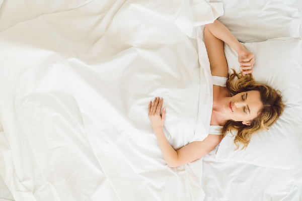 PRACTICE SLEEPING ON YOUR BACK TO REDUCE JOINT PAIN