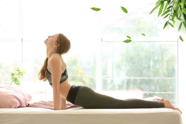 5 YOGA MOVES IN BED FOR A GOOD NIGHT'S SLEEP THAT EVERY INSOMNIAC SHOULD KNOW
